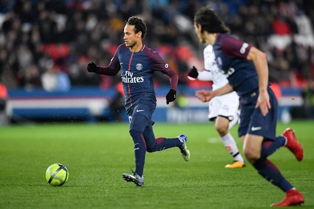 Paris Saint-Germain's Neymar runs with the ball during their French Ligue 1 match against Dijon, at the Parc des Princes stadium in Paris, on January 17, 2018 (AFP Photo/Christophe SIMON)