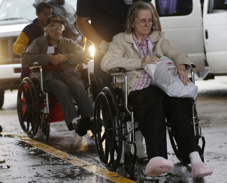 Residents of the Riverbend Nursing Center are evacuated to higher and safer ground as Isaac makes landfall as a hurricane, Wednesday, Aug. 29, 2012, in Jesuit Bend, La. Plaquemines Parish ordered a mandatory evacuation for the west bank of the Mississippi below Belle Chasse because of worries about a storm surge. The order affected about 3,000 people. (AP Photo/Eric Gay)