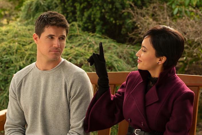 """Nathan (Robbie Amell) and Nora (Andy Allo) develop a relationship amid a digital afterlife landscape in Amazon's """"Upload."""""""