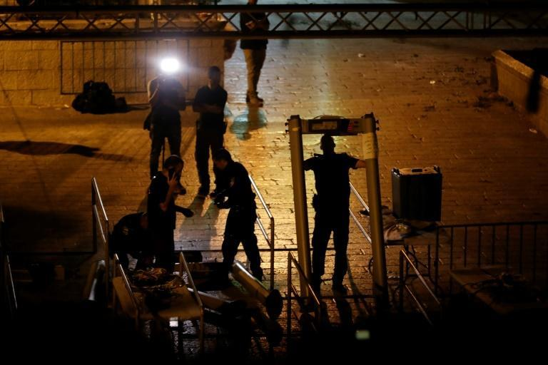 Israeli security forces remove metal detectors they had installed at the Lions' Gate entrance to Jerusalem's Al-Aqsa mosque compound on July 24, 2017
