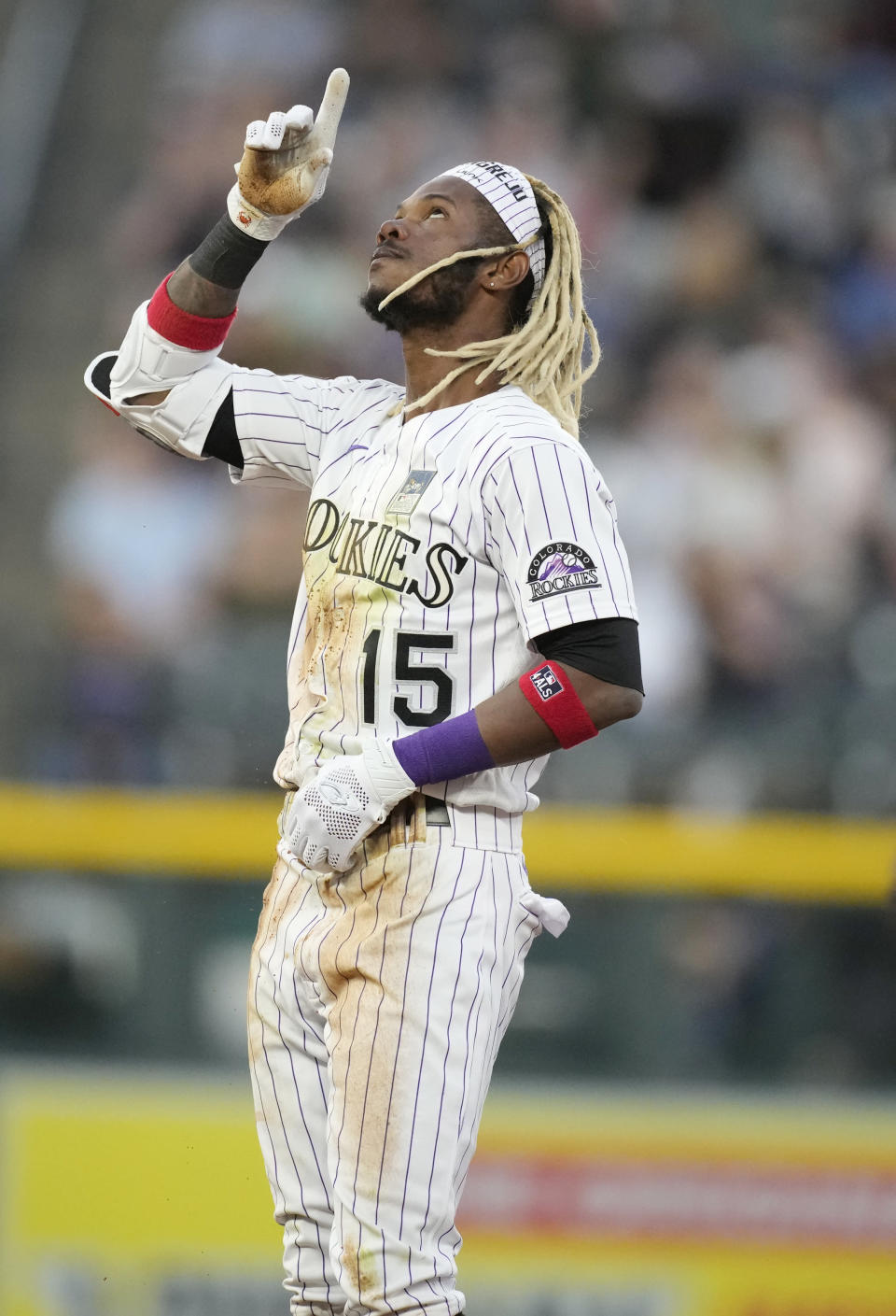Colorado Rockies' Raimel Tapia gestures after reaching second base with a double off Texas Rangers starting pitcher Jordan Lyles during the fifth inning of a baseball game Wednesday, June 2, 2021, in Denver. (AP Photo/David Zalubowski)