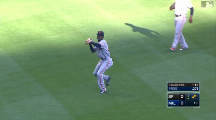 Giants outfielder Orlando Calixte's throwing attempt did not go well. (MLB.com Screenshot)