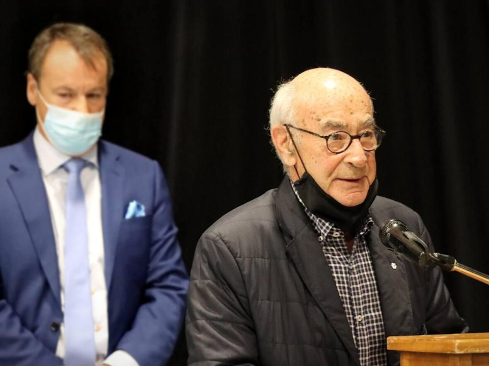 Harbour Royale Development president Marty Chernin, backed by his lawyer, Dwight Rudderham, speaks at a CBRM council meeting in Centre 200 on Tuesday, Oct. 12, 2021. (Tom Ayers/CBC - image credit)