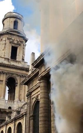 A smoke rises from Saint-Sulpice church in Paris, France, March 17, 2019 in this still image taken from a social media video obtained on March 18, 2019.  INSTAGRAM @agneswebste/via REUTERS via REUTERS ATTENTION EDITORS - THIS IMAGE HAS BEEN SUPPLIED BY A THIRD PARTY. MANDATORY CREDIT. NO RESALES. NO ARCHIVES