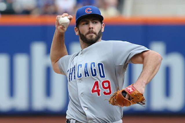 Chicago Cubs starting pitcher Jake Arrieta (49) throws during the first inning of a baseball game against the New York Mets at Citi Field, Sunday, Aug. 17, 2014, in New York. (AP Photo/John Minchillo)