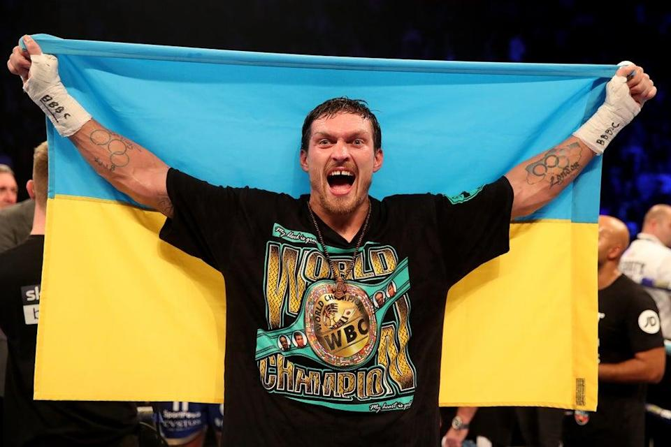 Usyk celebrates after defeating Tony Bellew (PA Archive)