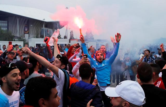 Soccer Football - Europa League Final - Olympique de Marseille vs Atletico Madrid - Lyon, France - May 16, 2018 Marseille fans with flares outside the stadium before the match REUTERS/Denis Balibouse