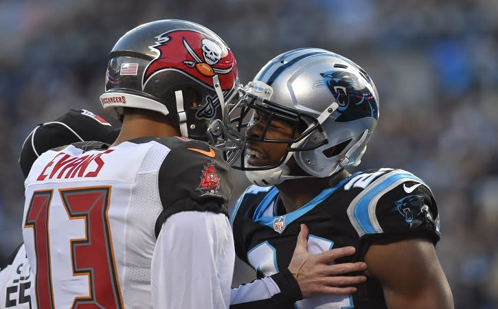 Jan 3, 2016; Charlotte, NC, USA; Tampa Bay Buccaneers wide receiver Mike Evans (13) and Carolina Panthers cornerback Josh Norman (24) are separated by the referee in the first quarter at Bank of America Stadium. Mandatory Credit: Bob Donnan-USA TODAY Sports