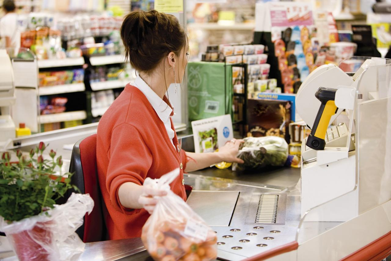 <p>No. 10 lowest-paid job: Cashier<br />Average full-time hourly wage: $13.95<br />(PhotoAlto / James Hardy / Getty Images) </p>