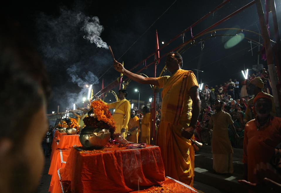 Indian hindu priests offer evening prayers on the banks of Yamuna river after Supreme Court's verdict on a disputed religious site, in Ayodhya, India, November 9, 2019. Hindus will get the entire disputed 2.77 acres in Ayodhya, SC has ruled 9 years after the Allahabad HC ruling. Muslims will get alternative land either in the surplus 67 acres acquired by central govt around the disputed structure or at another prominent place. (Photo by Ritesh Shukla/NurPhoto via Getty Images)