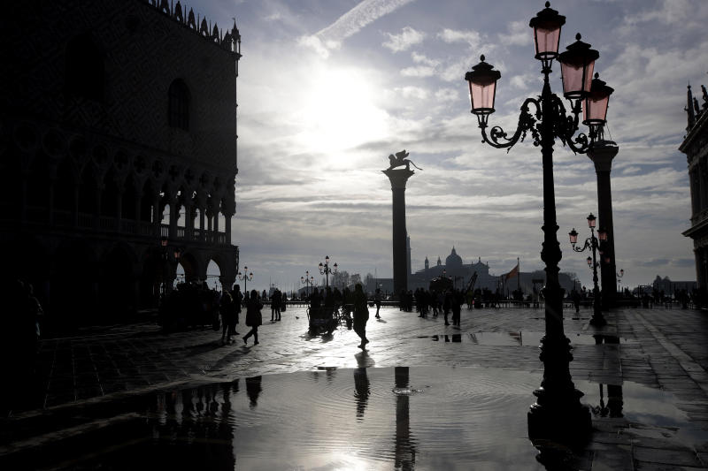 Water starts rising again in Venice, Italy, Saturday, Nov. 16, 2019. High tidal waters returned to Venice on Saturday, four days after the city experienced its worst flooding in 50 years. (AP Photo/Luca Bruno)