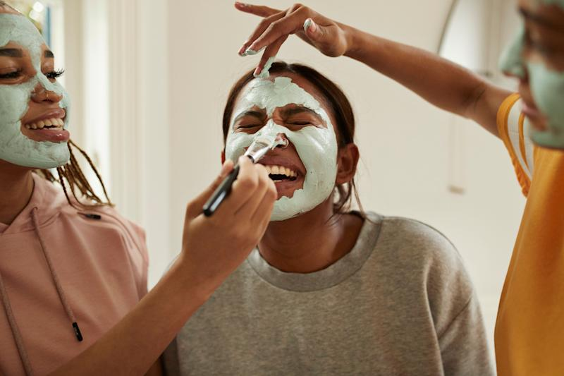 Applying a face mask can restore and hydrate the skin — and is a small, easy act of self-care. (Photo: Klaus Vedfelt via Getty Images)