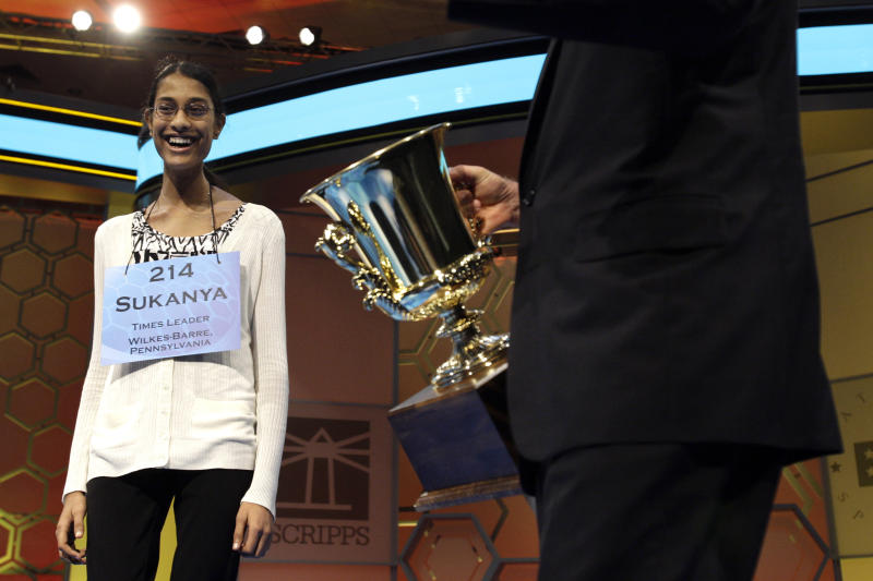Sukanya Roy, 14, of South Abington Township, Pa., is presented the trophy after winning the National Spelling Bee, in Oxon Hill, Md. on Thursday, June 2, 2011. She won by spelling the word cymotrichous, which means wavy hair.  (AP Photo/Jacquelyn Martin)