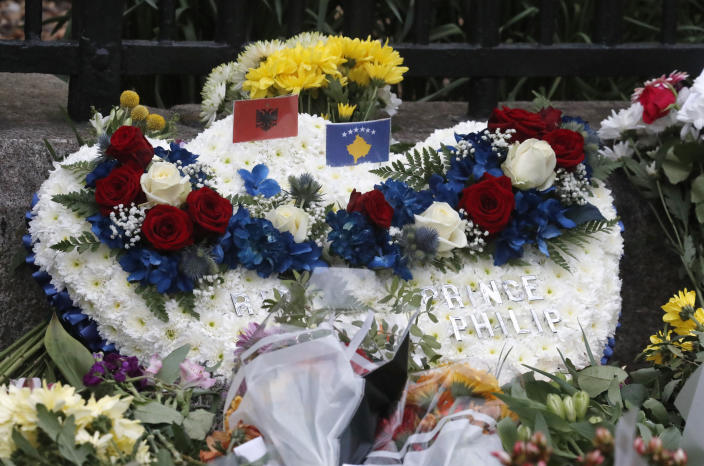 A flower wreath is left outside the gates of Windsor Castle, a day after the death of Britain's Prince Philip, in Windsor, England, Saturday, April 10, 2021. Britain's Prince Philip, the irascible and tough-minded husband of Queen Elizabeth II who spent more than seven decades supporting his wife in a role that mostly defined his life, died on Friday. (AP Photo/Frank Augstein)
