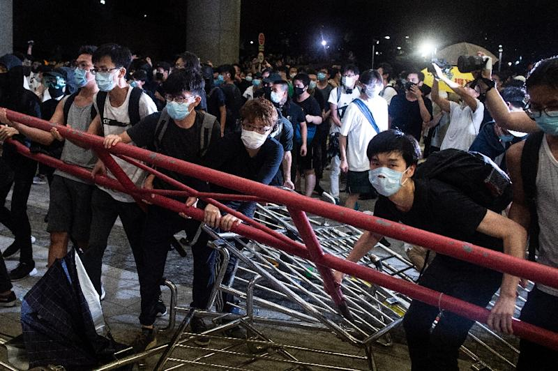 A massive peaceful protest in Hong Kong against plans to allow extraditions to the Chinese mainland descended into violence as police clashed with pockets of demonstrators (AFP Photo/Philip FONG)