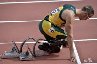 South Africa's Oscar Pistorius prepares to start in a men's 400-meter heat during the athletics in the Olympic Stadium at the 2012 Summer Olympics, London, Saturday, Aug. 4, 2012.(AP Photo/Martin Meissner)