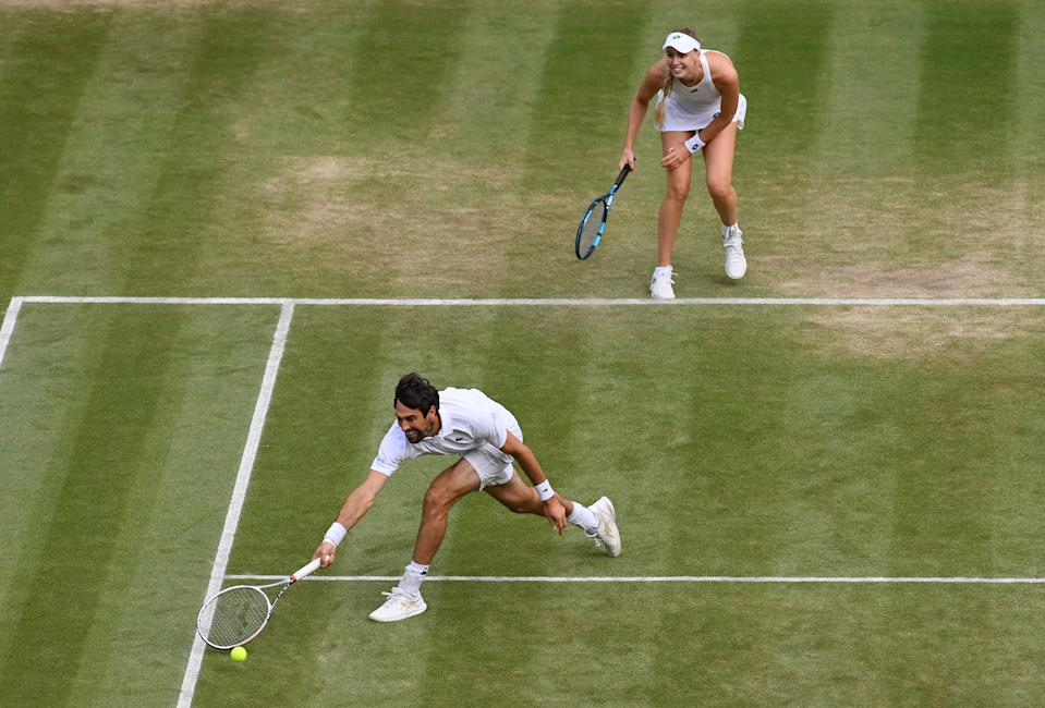 Jeremy Chardy of France, playing partner of Naomi Broady of Great Britain stretches to play a forehand in their Mixed Doubles Quarter-Final match against Joe Salisbury and Harriet Dart of Great Britain on Day Ten of The Championships - Wimbledon 2021 at All England Lawn Tennis and Croquet Club on July 08, 2021 in London, England. (Photo by Mike Hewitt/Getty Images)