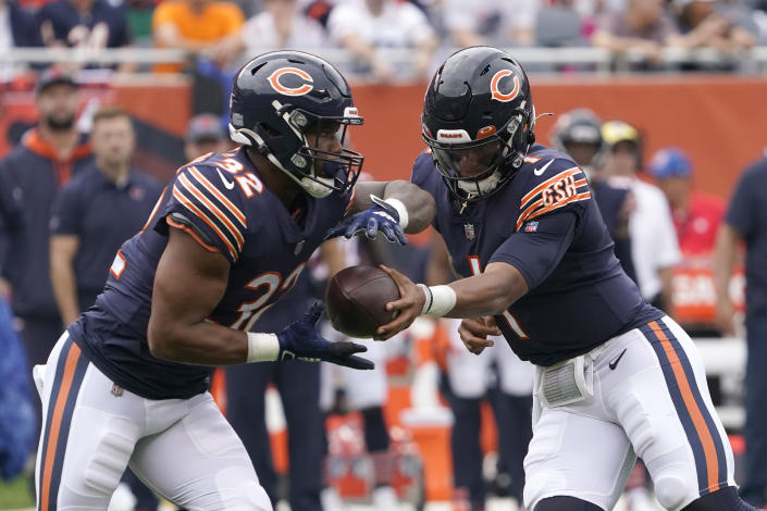 Chicago Bears quarterback Justin Fields hands off to running back David Montgomery during the first half of an NFL football game against the Detroit Lions Sunday, Oct. 3, 2021, in Chicago. (AP Photo/David Banks)
