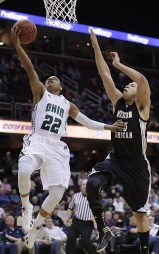 Ohio's Stevie Taylor (22) goes to the basket against Western Michigan's David Brown during the second half of an NCAA college basketball game in the semifinals of the Mid-American Conference men's tournament Friday, March 15, 2013, in Cleveland. Ohio won 74-63. (AP Photo/Tony Dejak)