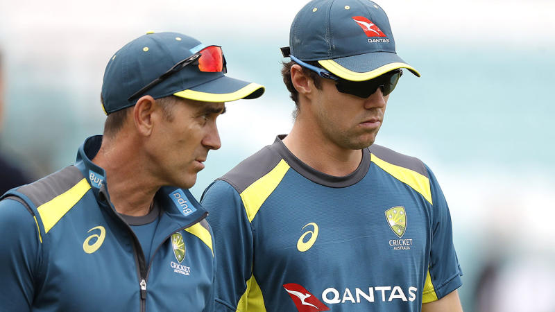 Justin Langer and Travis Head, pictured here speaking at a training session.