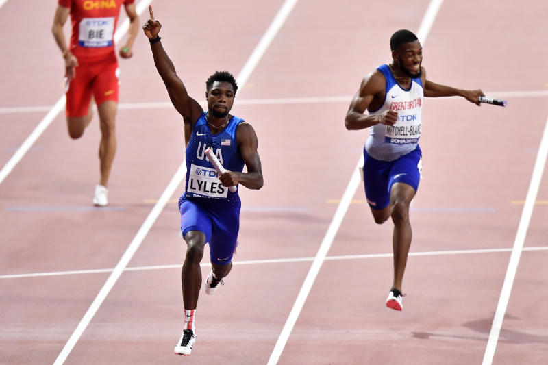 Noah Lyles of the United States crosses the finish line to win the men's 4x100 meter relay final ahead of silver medalist Nethaneel Mitchell-Blake of Great Britain & NI during the World Athletics Championships in Doha, Qatar, Saturday, Oct. 5, 2019. (AP Photo/Martin Meissner)
