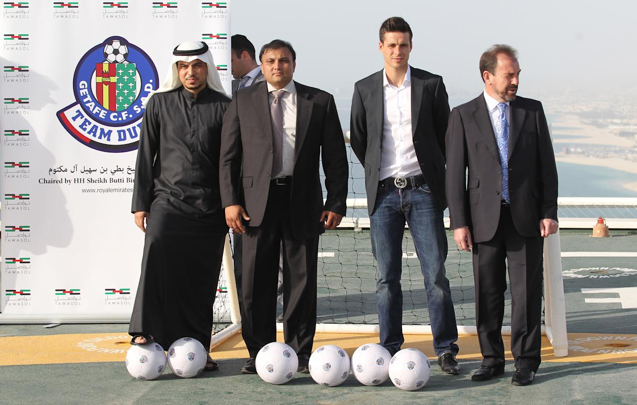 "Suleiman al-Butti, (2R), project manager of Royal Emirates Group, Angel Torres, (R), president of Spanish La Liga football club Getafe, Kaiser Rafiq, the group's managing director (2L) and Spanish striker Manu del Moral (2R) pose after Royal Emirates Group, which is chaired by a member of Dubai's ruling Al-Maktoum family, announced it has signed a deal to buy struggling football club Getafe, on April 21, 2011 in Dubai. Rafiq told a news conference in Dubai it has agreed to buy 100 percent of the club for ""between 70 and 90 million euros"" (101 and 130 million dollars), with the exact amount confidential.