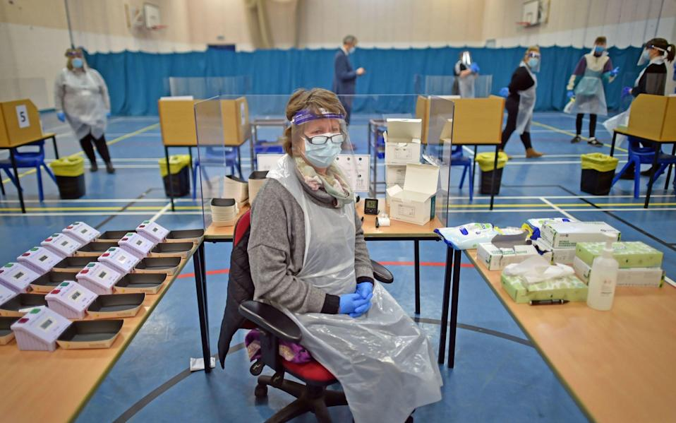 Science Technician Penny Townsend waits for lateral flow test results at Archway School in Stroud in Gloucestershire. - PA