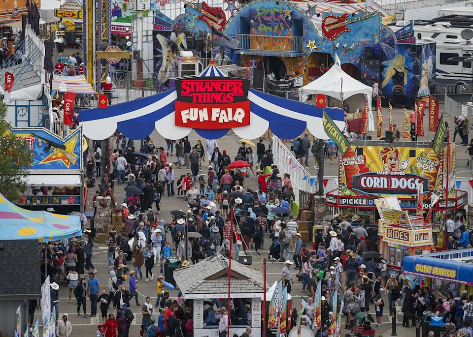 Crowds flock to the midway at the Calgary Stampede in Calgary on July 7, 2019. The Calgary Stampede has been cancelled this year because of COVID-19. (Photo: Jeff McIntosh/THE CANADIAN PRESS)