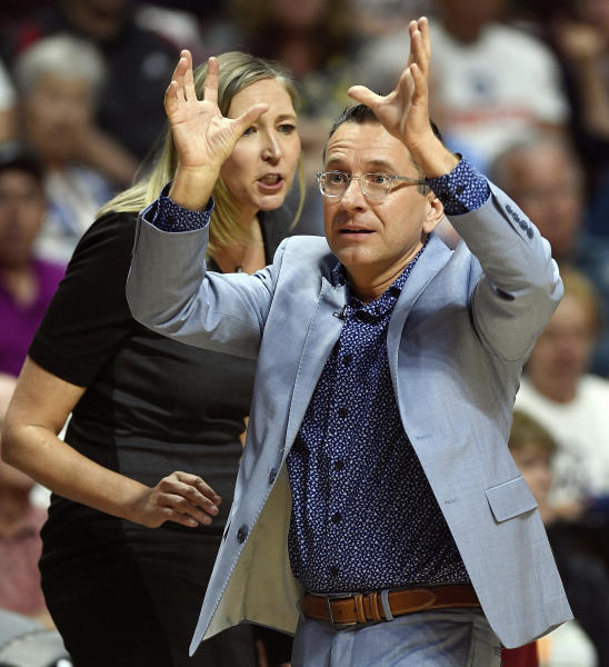 FILE - In this June 16, 2019, file photo, Connecticut Sun head coach Curt Miller, with assistant coach Brandi Poole behind, argues a call with the officials during play against the Seattle Storm in a WNBA basketball game, in Uncasville, Conn. No team has gotten off to a hotter start then the Connecticut Sun. (Sean D. Elliot/The Day via AP)
