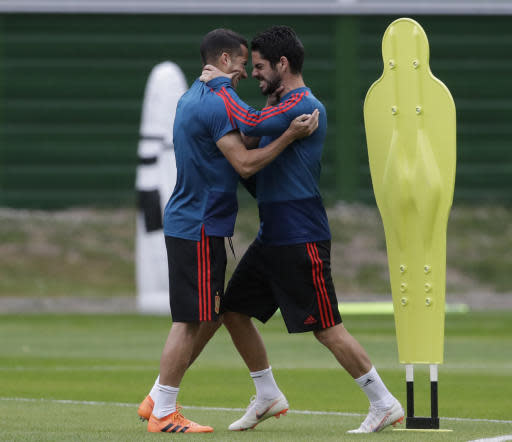Spain's Isco, right, smiles with Spain's Lucas Vazquez, left, during the official training on the eve of the group B match between Morocco and Spain at the Mirny stadium in Kaliningrad, Russia, Sunday, June 24, 2018. (AP Photo/Petr David Josek)