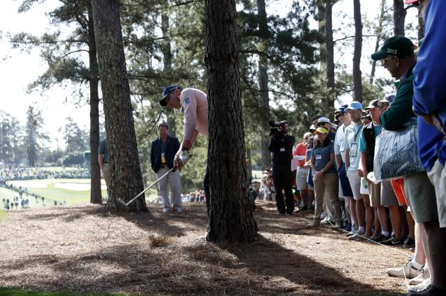 Matt Kuchar of the U.S. hits from behind a tree on the first hole during second round play of the 2018 Masters golf tournament at the Augusta National Golf Club in Augusta, Georgia, U.S., April 6, 2018. REUTERS/Jonathan Ernst