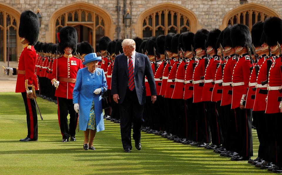 U.S. President Donald Trump and Britain's Queen Elizabeth inspect the Coldstream Guards during a visit to Windsor Castle in Windsor, Britain, July 13, 2018. REUTERS/Kevin Lamarque