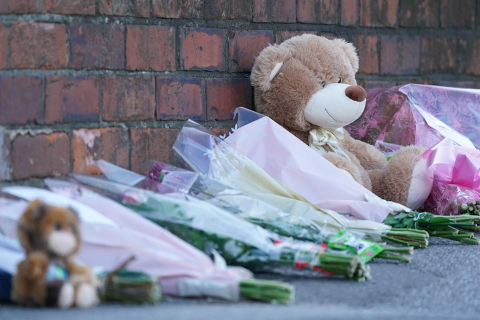 Floral tributes and teddy bears are left at the scene in High Holme Road, Louth, Lincolnshire, following the death of a woman and child on Monday. Picture date: Tuesday June 1, 2021.