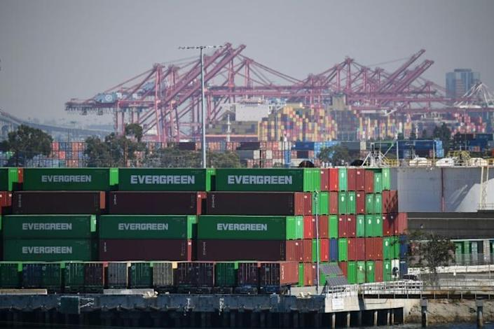Containers and cranes are seen at the Port of Los Angeles, in California on October 13, 2021 (AFP/Robyn Beck)