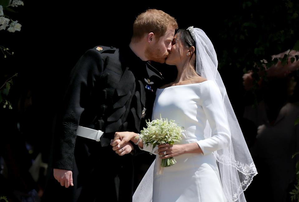 Prince Harry and Meghan Markle kiss outside St George's Chapel in Windsor Castle after their wedding. (Photo by Jane Barlow/PA Images via Getty Images)