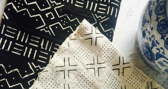 """<a href=""""Mud cloth is a centuries-old, hand-dyed textile art that originated in West Africa with the women of Mali's Bamana culture"""" target=""""_blank"""">Mud cloth</a> is a centuries-old, hand-dyed textile art that originated in West Africa with the women of Mali's Bamana culture."""