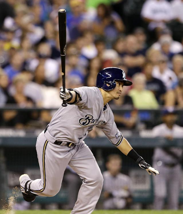 Milwaukee Brewers' Norichika Aoki takes off on a grounder against the Seattle Mariners in the first inning of a baseball game Saturday, Aug. 10, 2013, in Seattle. Aoki was out on the play. (AP Photo/Elaine Thompson)