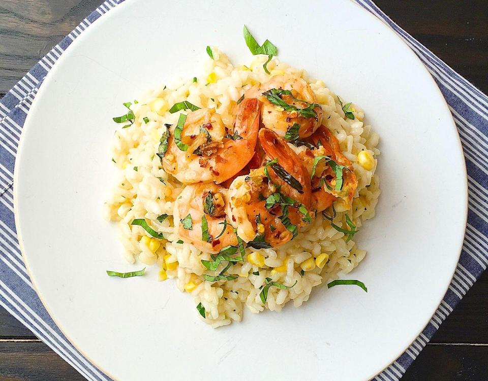 """<p><span>This is the lightest comforting meal you'll ever make.</span></p><p><span>Get the recipe from </span><a href=""""https://www.delish.com/cooking/recipe-ideas/recipes/a43431/sweet-corn-risotto-sauteed-shrimp-recipe/"""" rel=""""nofollow noopener"""" target=""""_blank"""" data-ylk=""""slk:Delish"""" class=""""link rapid-noclick-resp"""">Delish</a><span>.</span> </p>"""