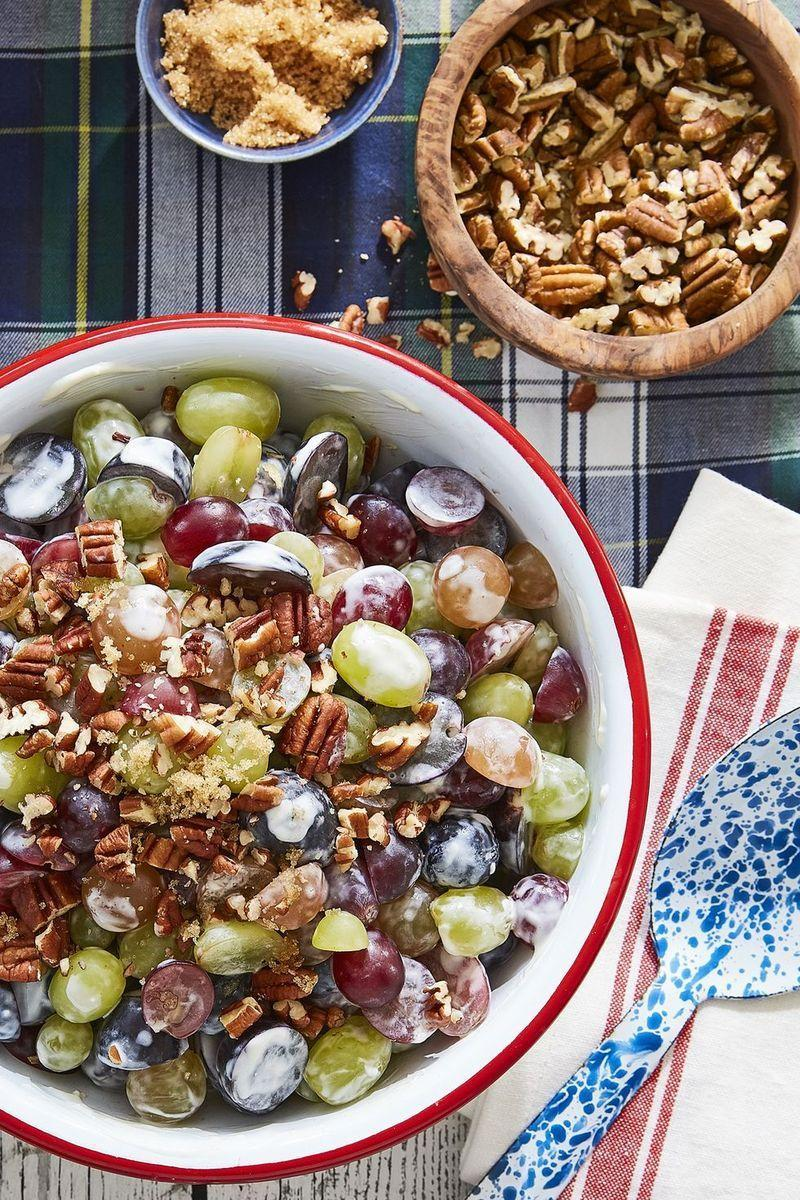 """<p>This salad is not only sweet and satisfying (thanks to brown sugar and pecans), but it's also incredibly easy to make too. </p><p><strong><a href=""""https://www.countryliving.com/food-drinks/recipes/a45296/grape-salad-recipe/"""" rel=""""nofollow noopener"""" target=""""_blank"""" data-ylk=""""slk:Get the recipe"""" class=""""link rapid-noclick-resp"""">Get the recipe</a>. </strong> </p>"""