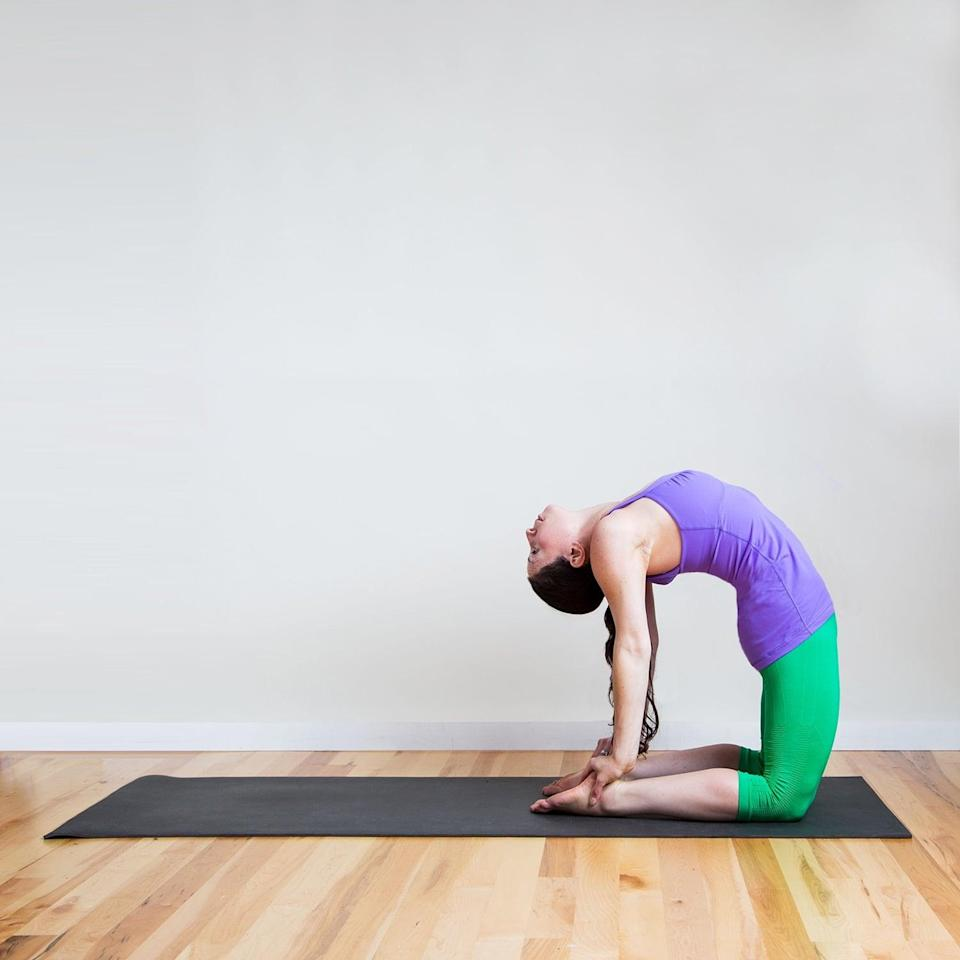 """<ul> <li>Kneel at the front of your mat with your knees under your hips, shins parallel.</li> <li>Reach your right hand back toward your right heel, and then your left toward your left heel. Your hands are there for balancing support, so don't lean all your weight into them.</li> <li>Try to shift weight forward into your knees, which will also increase the stretch you feel in your belly and chest.</li> <li>Lower your head behind you and stay here for five breaths.</li> </ul> <p>Related: <a href=""""https://www.popsugar.com/fitness/Foods-Decrease-Belly-Fat-19237195?utm_medium=partner_feed&utm_source=smartnews&utm_campaign=related%20link"""" rel=""""nofollow noopener"""" target=""""_blank"""" data-ylk=""""slk:The 5 Best Belly-Flattening Foods"""" class=""""link rapid-noclick-resp"""">The 5 Best Belly-Flattening Foods</a></p>"""