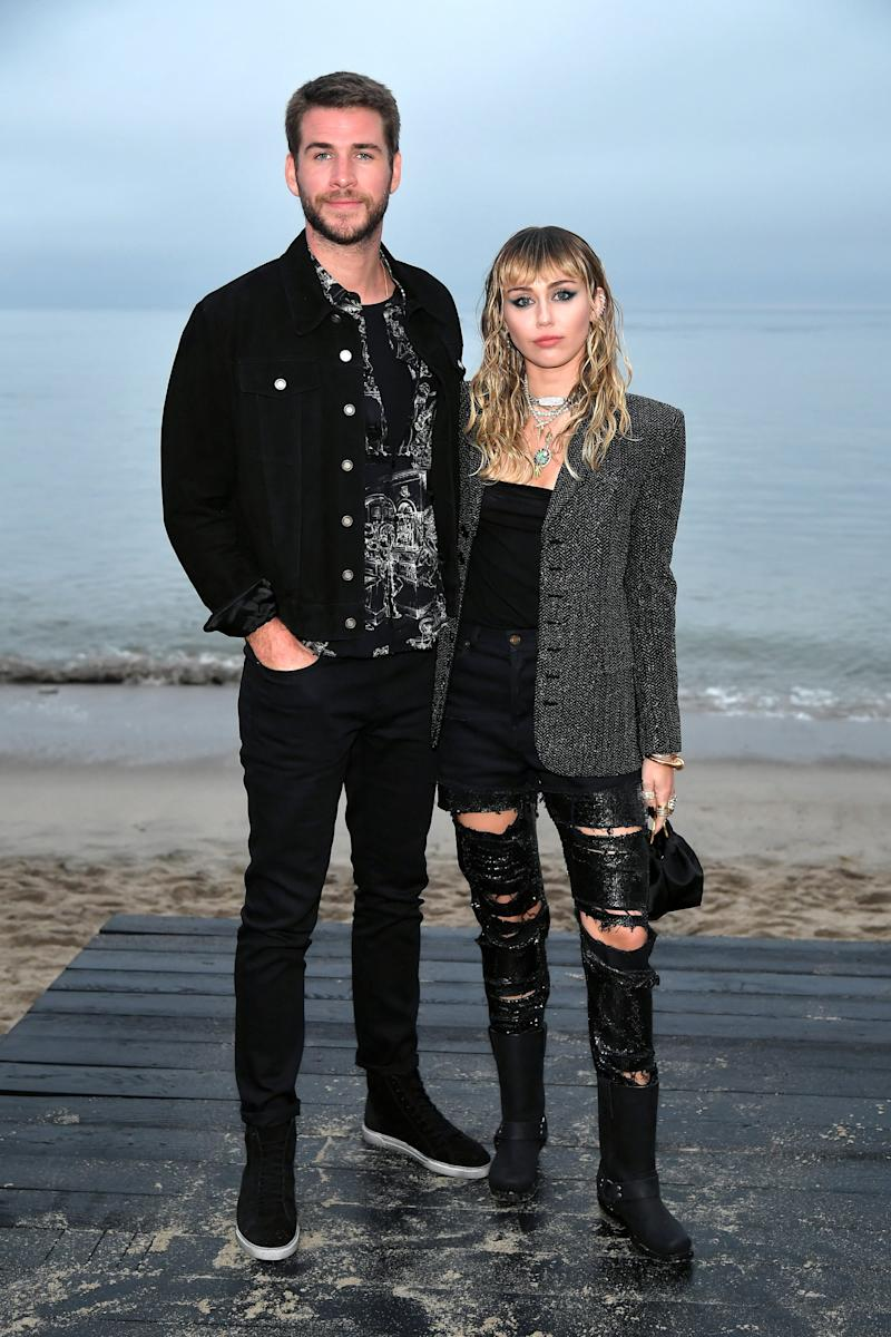 MALIBU, CALIFORNIA - JUNE 06: (L-R) Liam Hemsworth and Miley Cyrus attend the Saint Laurent Mens Spring Summer 20 Show on June 06, 2019 in Paradise Cove Malibu, California. (Photo by Neilson Barnard/Getty Images)