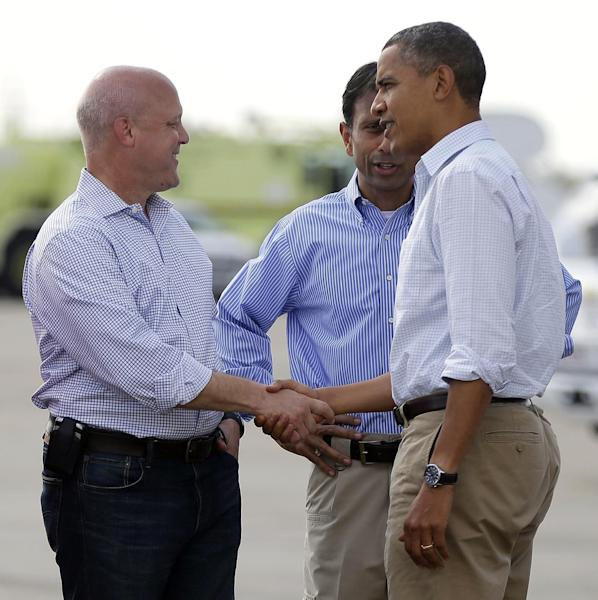 President Barack Obama, right, is greeted by Gov. Bobby Jindal, center, and New Orleans Mayor Mitch Landrieu, left, at Louis Armstrong New Orleans International Airport, Monday, Sept. 3, 2012, in Kenner, La. Obama traveled to the region to view the ongoing response and recovery efforts to Hurricane Isaac. (AP Photo/Pablo Martinez Monsivais)