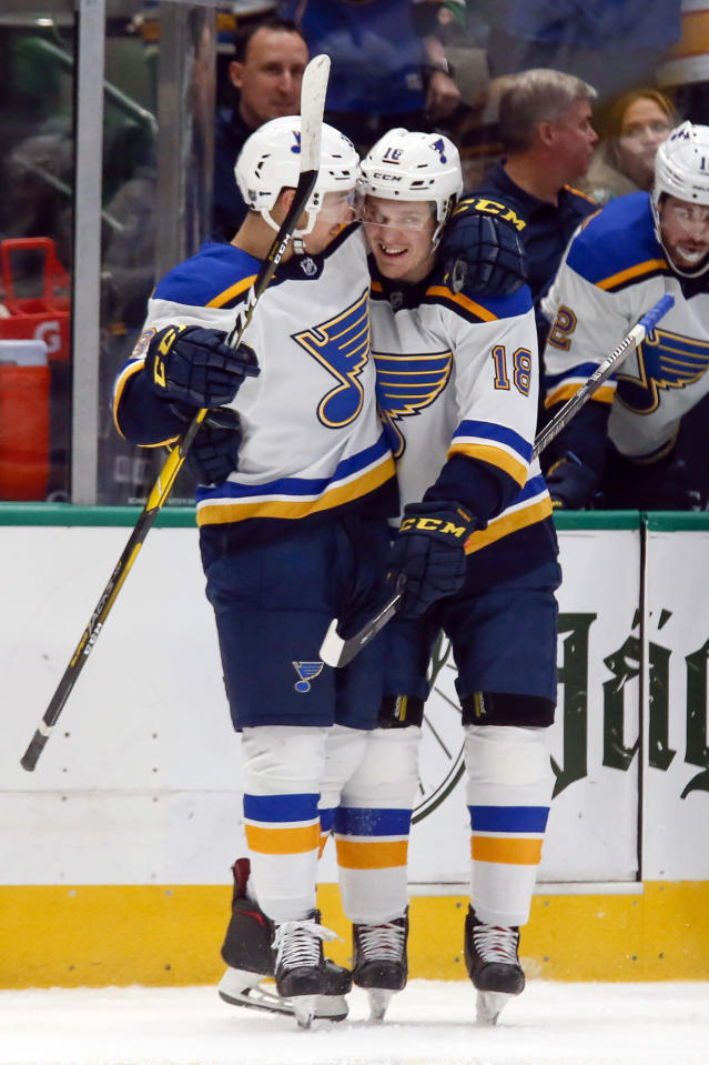 St. Louis Blues center Jordan Kyrou, left, hugs center Robert Thomas after Kyrou scored a goal against the Dallas Stars during the second period of an NHL hockey game in Dallas, Friday, Feb. 21, 2020. (AP Photo/Ray Carlin)