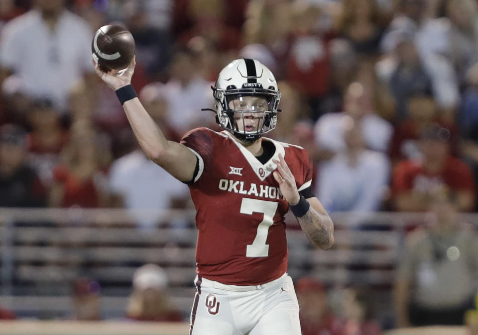 Oklahoma quarterback Spencer Rattler (7) passes against West Virginia during the second half of an NCAA college football game in Norman, Okla., Saturday, Sept. 25, 2021. (AP Photo/Alonzo Adams)