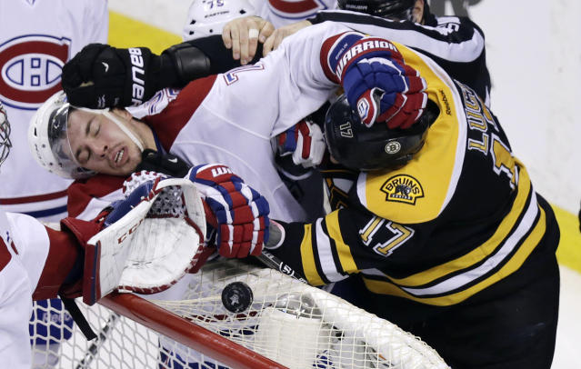 Boston Bruins left wing Milan Lucic, right, tangles with Montreal Canadiens right wing Brendan Gallagher (11) during the third period of Game 2 in the second-round of the Stanley Cup hockey playoff series in Boston, Saturday, May 3, 2014. The Bruins defeated the Canadiens 5-3, tying the best-of-seven games series at one game each. (AP Photo/Charles Krupa)