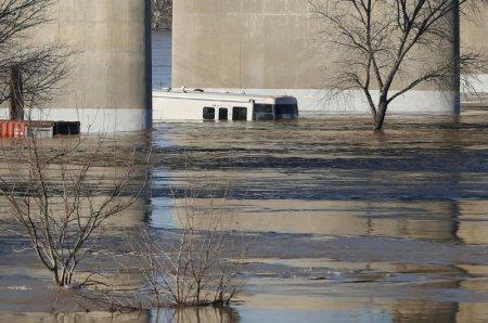 FILE PHOTO: A motorhome is flooded in Marysville, California, after an evacuation was ordered for communities downstream from the dam in Oroville, California, U.S., February 14, 2017. REUTERS/Jim Urquhart/File Photo