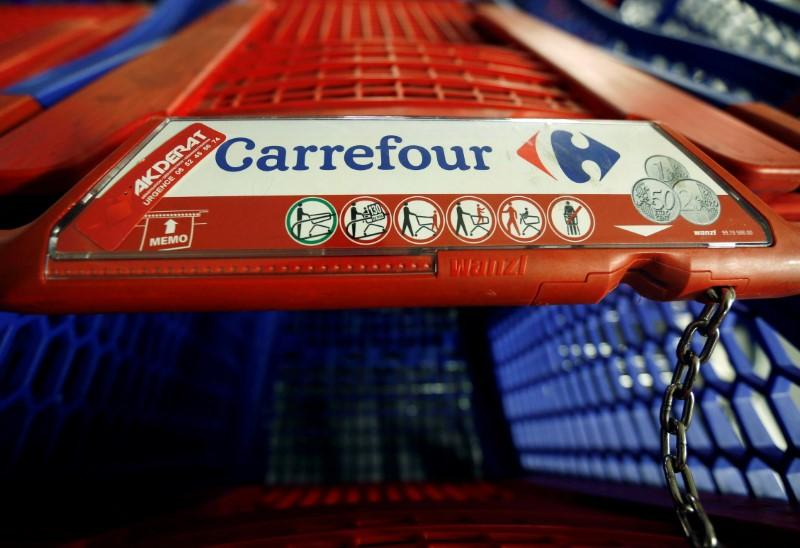 FILE PHOTO: A Carrefour logo is seen on a shopping trolley at a Carrefour Hypermarket store in Montreuil, near Paris
