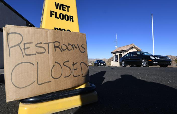 Tourists drive past the closed entrance ticket station of the Joshua Tree National Park after the federal government's partial shutdown caused park rangers to stay home and campgrounds to be shut, at the park in California, on Jan. 3, 2019. (Photo: Mark Ralston/AFP/Getty Images)