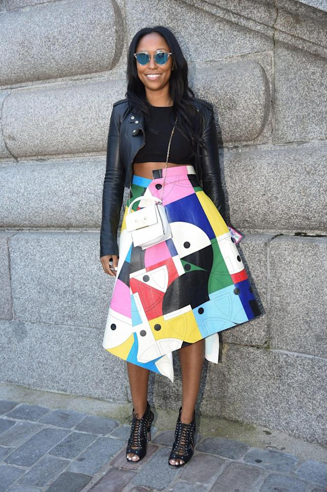 <p>Turini played down her multi-colored Junya Watanabe skirt with a black YSL jacket and a white Armani mini bag. (Getty Images) <br /></p>