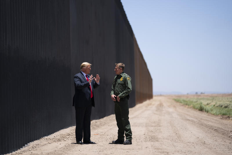 United State Border Patrol chief Rodney Scott gives President Donald Trump a tour of a section of the border wall, Tuesday, June 23, 2020, in San Luis, Ariz. (AP Photo/Evan Vucci)